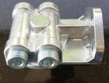 Externý relokačný držiak olejového filtra - 4x bočné výstupy